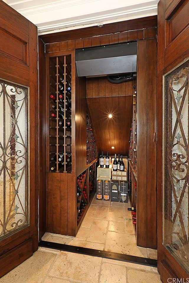refrigerated wine storage with antique french doors